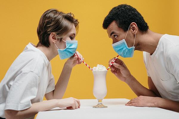 couple-wearing-face-mask-drinking-milkshake-3951901